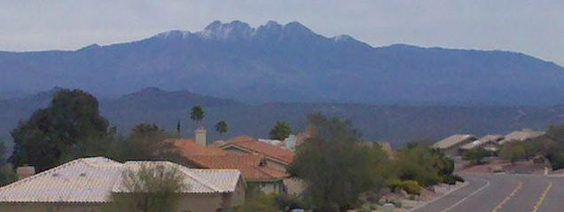 Arizona real estate view of the snow capped Four Peaks mountains east of Fountain Hills, AZ in mid-January